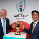 Chairman of World Rugby Bill Beaumont (L) and Japan's Prime Minister Shinzo Abe pose with the William Webb Ellis Cup during the Rugby World Cup 2019 pool draw at the Kyoto State guesthouse in Kyoto. Pic AFP PHOTO / WORLD RUGBY/ DAVE ROGERS