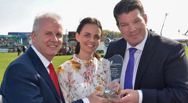 Ashley Orr of Willowbrook Foods receives last year's overall local supplier of the year award from Paddy Doody and Neal Kelly of Henderson Group