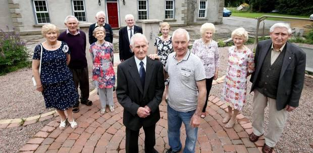 From left to right: Kathleen (74), Seamus (79), Terry (80), Rose (84), Tony (82), Sean (92), Mairead (85), Leo (70), Eileen (89), Maureen (91), Peter (86) with Paul Muldoon who narrated the first documentary