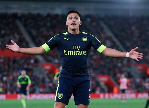 Arsenal's Alexis Sanchez celebrates scoring his side's first goal of the game during the Premier League match at St Mary's, Southampton. PA