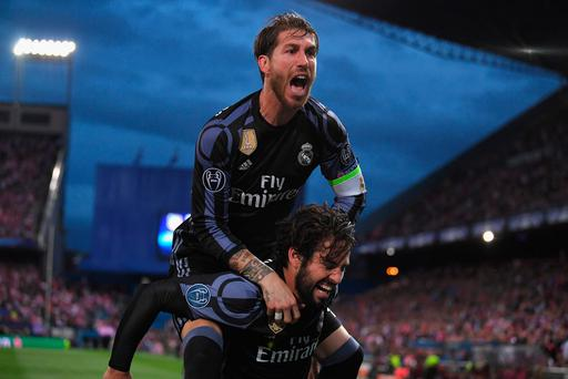 Isco (bottom) of Real Madrid celebrates scoring his team's opening goal with Sergio Ramos during the UEFA Champions League Semi Final second leg match between Club Atletico de Madrid and Real Madrid CF at Vicente Calderon Stadium on May 10, 2017 in Madrid, Spain. (Photo by Laurence Griffiths/Getty Images)