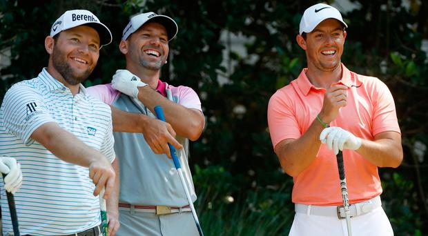 All smiles: Branden Grace, Sergio Garcia and Rory McIlroy share a joke in yesterday's practice round at TPC Sawgrass in Florida