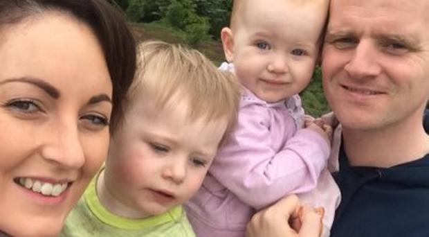 Family man: Barry Gray with his wife Caoimhe and children Noah and Ella