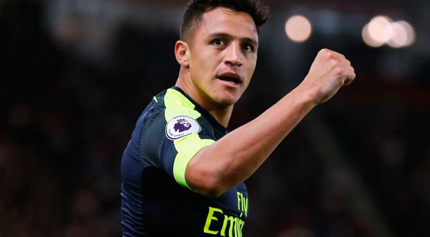 Goal ace: Alexis Sanchez after putting Arsenal on the way to victory last night at Southampton