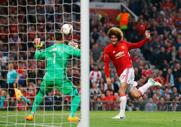 Manchester United's Marouane Fellaini scores his side's first goal of the game during the UEFA Europa League, Second Leg match at Old Trafford, Manchester. PA