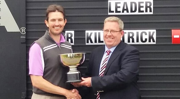 Cup of cheer: Richard Kilpatrick is presented with the Ruddy Cup at the European Club, Co Wicklow yesterday