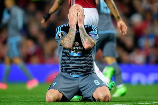 Celta Vigo's Swedish striker John Guidetti reacts after missing a good chance during the UEFA Europa League semi-final, second-leg football match between Manchester United and Celta Vigo at Old Trafford stadium in Manchester, north-west England, on May 11, 2017. AFP/Getty Images