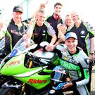 Winner: Martin Jessopp celebrates victory with his team during the Supersport race last night at the NW200. Photo: Stephen Davison/Pacemaker