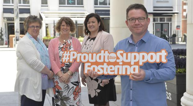 Proud to support fostering: From left to right, Una Carragher (Fostering Network) Carol Diffen (Belfast Trust) Kathleen Toner (Fostering Network) and Sean McGivern (Foster Carer).