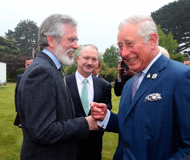 Sinn Fein leader Gerry Adams and Sean Haughey meet the Prince of Wales during a reception at Glencairn House, Dublin in the Republic of Ireland. PA