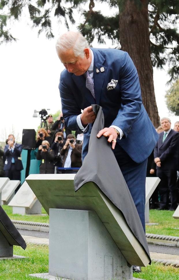 The Prince of Wales unveils a Victoria Cross paving stone in memory of Corporal John Cunningham at the Cross of Sacrifice in Glasnevin cemetery, Dublin in the Republic of Ireland. PRESS ASSOCIATION Photo. Picture date: Friday May 12, 2017. The Prince of Wales and the Duchess of Cornwall are on a three day visit to Ireland. See PA story ROYAL Ireland. Photo credit should read: Lorraine O'Sullivan/PA Wire