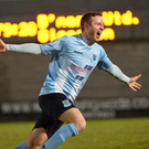 Cashing in: Kevin Braniff celebrates his winner against former club Glenavon last night