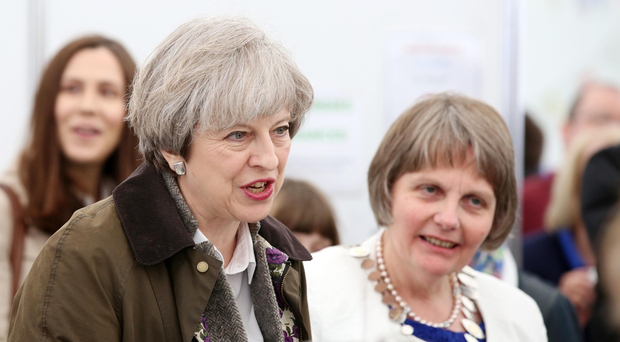 Elizabeth Warden (Federation Chairman) Women's Institute and Secretary of State for Northern Ireland James Brokenshire accompany the Prime Minister Theresa May on her visit to the Balmoral Show. Photo by Darren Kidd / Press Eye