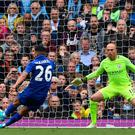 Manchester City's Argentinian goalkeeper Willy Caballero (R) stands by as Leicester City's Algerian midfielder Riyad Mahrez (L) takes his penalty, which hit his standing foot on the way to the goal, and was subsequently disallowed during the English Premier League football match between Manchester City and Leicester City at the Etihad Stadium in Manchester, north west England, on May 13, 2017. AFP/Getty Images