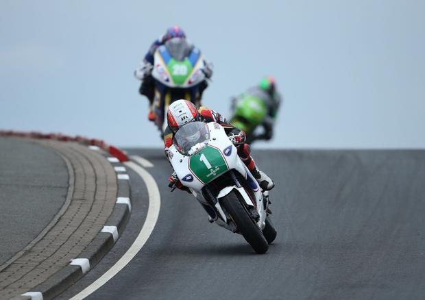 Michael Rutter Kawasaki leads Daniel Cooper Kawasaki and Martin Jessopp Riders Motorcycles Kawasaki over Black Hill during Saturday's John M Paterson Supertwin Race at the North West 200 around the 8.9 mile Triangle course. Photo: Brian Little/PressEye