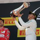 Number one: Mercedes' Lewis Hamilton celebrates after winning the Spanish Formula One Grand Prix as Ferrari driver and runner-up Sebastian Vettel looks on
