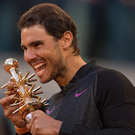 Champion: Nadal extended his record clay to 15-0 this season with a 7-6 (10/8) 6-4 win in Spain