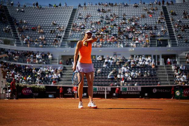Maria Sharapova of Russia wipes sweat form her face during a tennis match against Christina Mchale of the United States, at the Italian Open tennis tournament, in Rome, Monday, May 15, 2017. (AP Photo/Andrew Medichini)