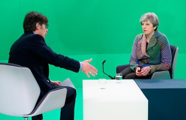 Prime Minister Theresa May with ITV News Political Editor Robert Peston taking part in the Facebook Live broadcast, hosted by ITV News where she answered questions sent in by users of the social media website. PA