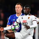 Watford's French striker M'Baye Niang (R) tries to hold off Chelsea's English defender John Terry (L) during the English Premier League football match between Chelsea and Watford at Stamford Bridge in London on May 15, 2017. / AFP PHOTO / Ben STANSALL / RESTRICTED TO EDITORIAL USE. No use with unauthorized audio, video, data, fixture lists, club/league logos or 'live' services. Online in-match use limited to 75 images, no video emulation. No use in betting, games or single club/league/player publications. / BEN STANSALL/AFP/Getty Images