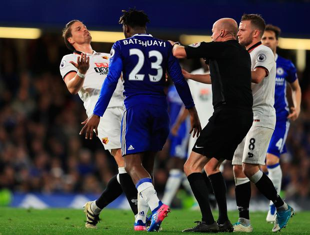 Sebastian Prodl of Watford and Michy Batshuayi of Chelsea clash as referee Lee Mason attempts to stop them during the Premier League match between Chelsea and Watford at Stamford Bridge on May 15, 2017 in London, England. (Photo by Richard Heathcote/Getty Images)