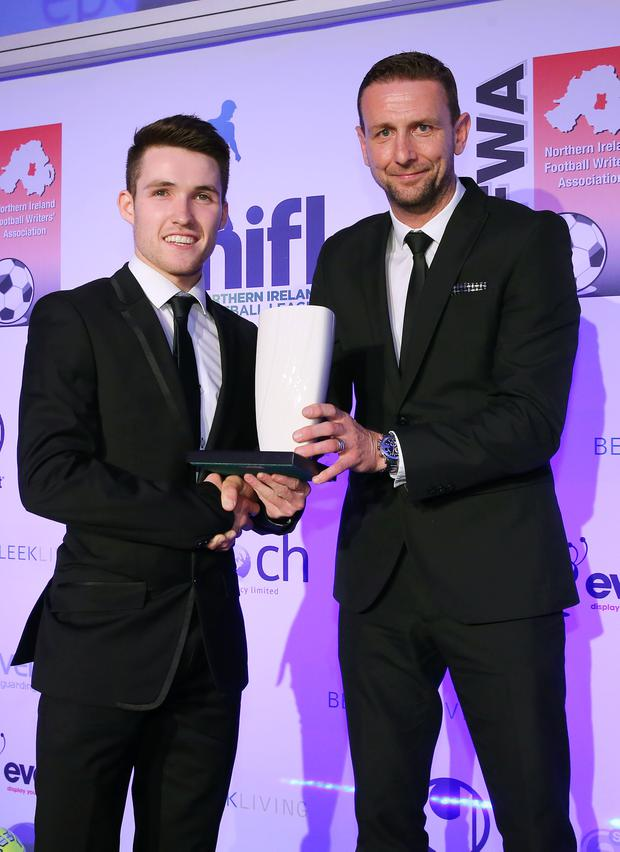 Northern Ireland Football Writers Awards at the Crowne Plaza, Belfast. Event Exhibition Young Player Of The Year: Northern Ireland's new Under 21 manager Ian Baraclough presents Linfield's Paul Smyth. 15th May 2017. Photo by Kelvin Boyes / Press Eye.