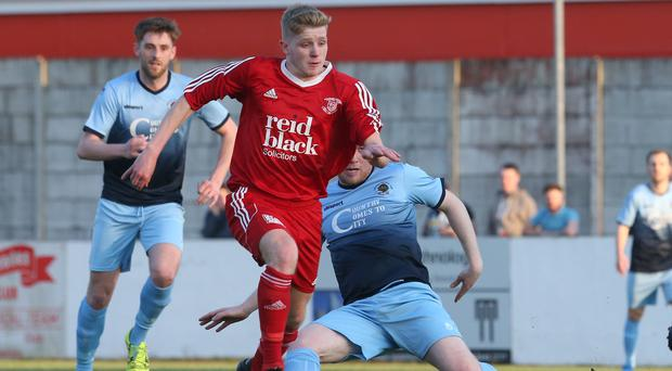 Corey McMullan in action during Ballyclare Comrades' play-off against Institute.