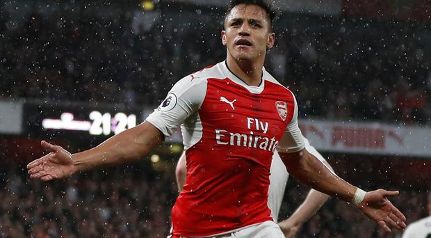 Arsenal's Chilean striker Alexis Sanchez celebrates scoring the second goal during the English Premier League football match between Arsenal and Sunderland at the Emirates Stadium in London on May 16, 2017. AFP/Getty Images