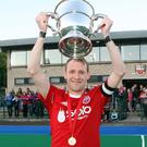 Cup cheer: Cookstown captain Greg Allen lifts the Anderson Cup after their win over Kilkeel