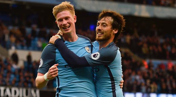 City slickers: Kevin De Bruyne celebrates with David Silva