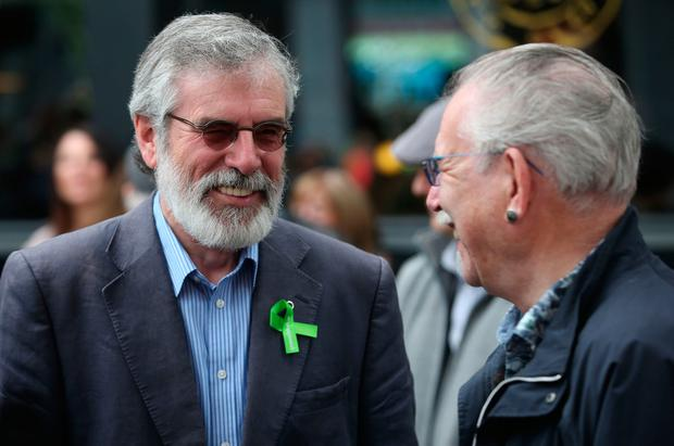 Sinn Fein's Gerry Adams (left) speaks to artist Robert Ballagh before a memorial ceremony in Dublin's Talbot Street marking the anniversary of the bombings in Dublin and Monaghan on May 17 1974. PA
