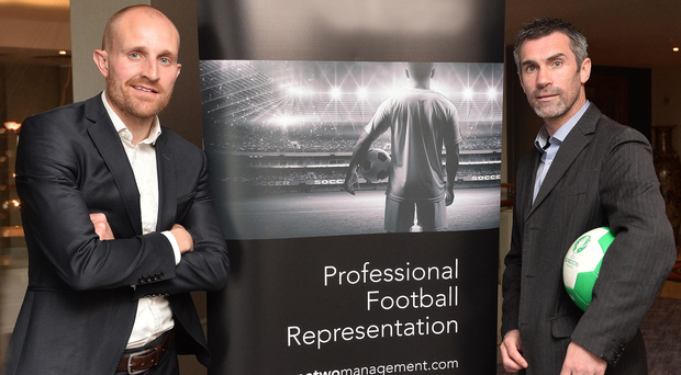 Suits you sir: Keith Gillespie (right) and Brian Adair at the launch of their new football agency in Belfast yesterday