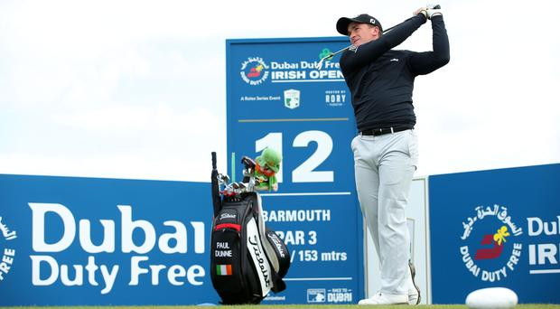 Paul Dunne hits into the par three 12th at the Dubai Duty Free Irish Open Media Day at Portstewart Golf Club.