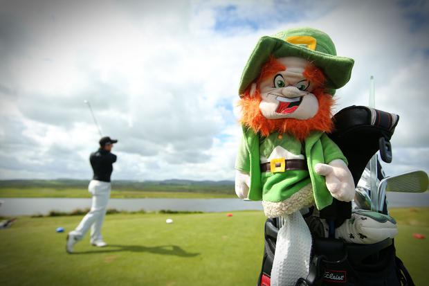 Luck of the Irish: Paul Dunne and his trusty mascot gets to grips with the course at the Dubai Duty Free Irish Open Media Day at Portstewart Golf Club