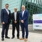 Invest NI chief Executive Alastair Hamilton, Hugh Njemanze of Anomali and Dr Godfrey Gaston, Operations Director, CSIT, the centre for cyber security research based at Queen's University Belfast. Photo by Kelvin Boyes / Press Eye.