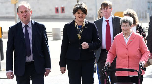 DUP Leader Arlene Foster and family and friends of those killed in the Kingsmill Massacre arriving at the inquest today, Thursday, May 18. Photo Colm Lenaghan/Pacemaker Press