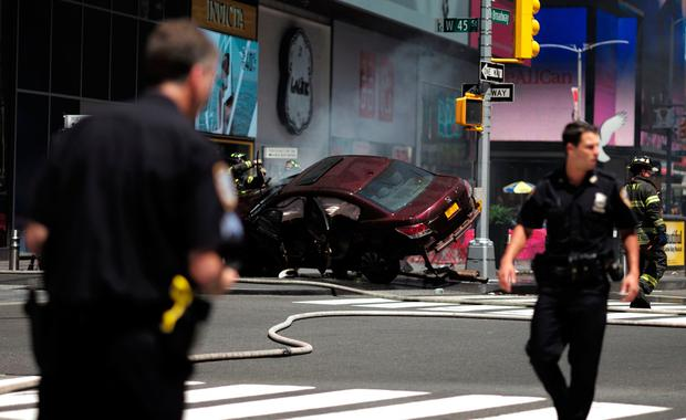 Police secure an are near a car after it plunged into pedestrians in Times Square in New York on May 18, 2017. AFP/Getty Images