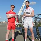 Head to head: Derry's Neil Forrester (left) and Tyrone's Ronan McNamee with the Anglo Celt Cup