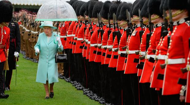The Queen inspecting the 1st Battalion and F Company Scots Guards at Buckingham Palace. (Photo by John Stillwell - WPA Pool/Getty Images)