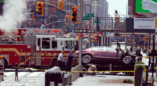 The shocking scenes after a car ploughed into a crowd of pedestrians in Times Square yesterday, leaving a young woman dead and many injured, some critically, in what officials said was not a terrorism-related event. (AP Photo/Seth Wenig)