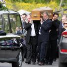 Family and friends carry Connie Leonard's coffin from the family home in Brookeborough to St Mary's Church in the town for require mass. Picture by Jonathan Porter/PressEye
