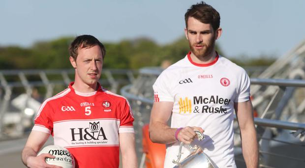 Derry's Neil Forrester and Tyrone's Ronan McNamee with the Anglo Celt Cup.