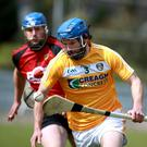 Flying high: John Dillon is in superb form at full-back as Antrim chase a third major coup
