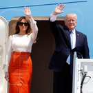 President Donald Trump and first lady Melania Trump wave as they board Air Force One to embark on his first overseas tour. (AP Photo/Alex Brandon)