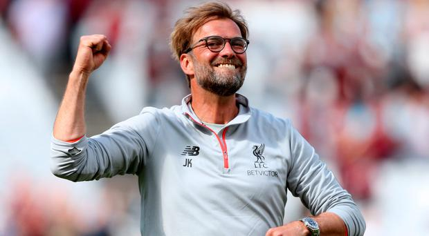 Clear aim: Jurgen Klopp knows Liverpool are just one win away from confirming their return to the Champions League