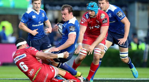 Crunch: Leinster's Rhys Ruddock is tackled by Aaron Shingler