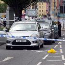 Police at the scene on the Albertbridge Road yesterday afternoon after an elderly man was knocked down