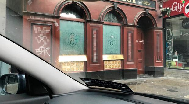 The George bar was vandalised with homophobic messages this morning. Photo: @ConanGShore/Twitter