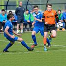 Dollingstown's Aaron Moffett (left) and Neil King in action with Portstewarts Eoghan Quigg.