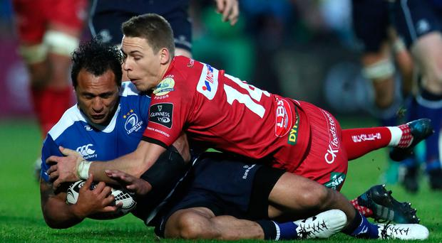 Brought down: Isa Nacewa tackled by Scarlet's Liam Williams